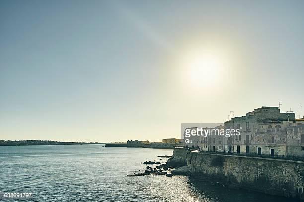 Waterfront houses on coast of Ortigia, Syracuse, Sicily, Italy