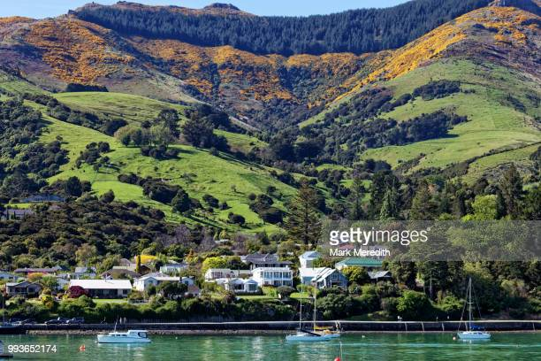Waterfront of Akaroa Harbour and mountains, morning