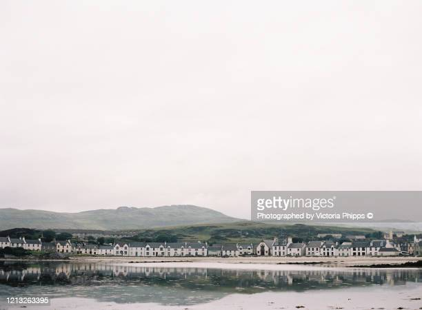 waterfront of port ellen, islay on a cloudy day - town stock pictures, royalty-free photos & images
