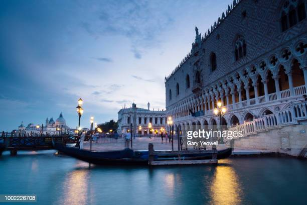 waterfront of st mark's square in venice at dusk - yeowell stock pictures, royalty-free photos & images