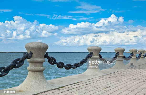waterfront pilings, chains and brick walkway along lake erie - cleveland ohio stock photos and pictures