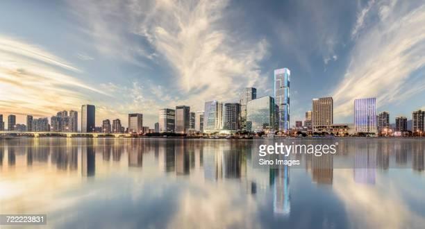 Waterfront skyscrapers reflecting on river surface, Fuzhou, Fujian, China