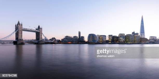 waterfront view of skyline across south of river thames, at twilight - river thames stock pictures, royalty-free photos & images