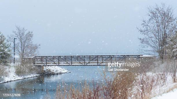 waterfront walking bridge - barrie stock pictures, royalty-free photos & images