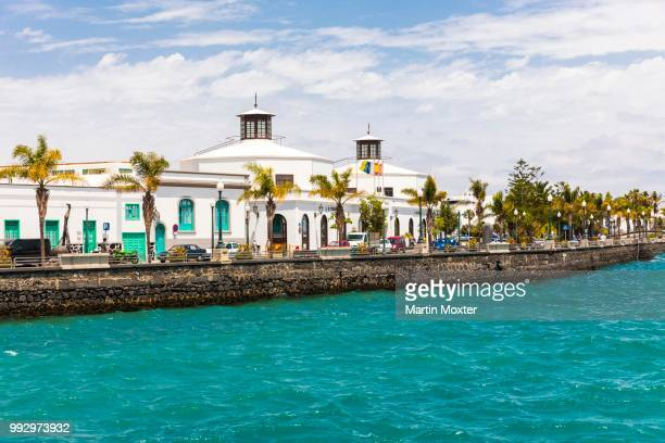 waterfront with av. olaf palme with the city council of arrecife, arrecife, lanzarote, canary islands, spain - arrecife stock photos and pictures