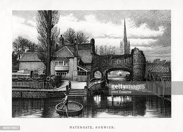Watergate Norwich 1896 A man in a circular boat on the River Wensum and in the background the 15thcentury water gate at Pull's Ferry