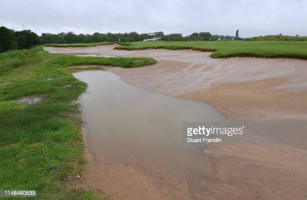 A waterlogged bunker is seen prior to the start of the delayed third round of the ATT Byron Nelson at the Trinity Forest Golf Club on May 11 2019 in...