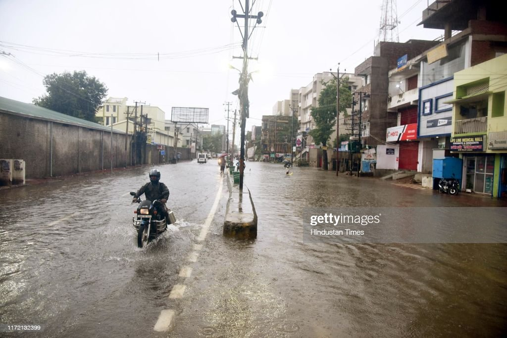 Patna Submerges In Waist-Deep Water As Unexpected Rains Hit Life In Bihar; 25 Dead, Trains Cancelled : News Photo