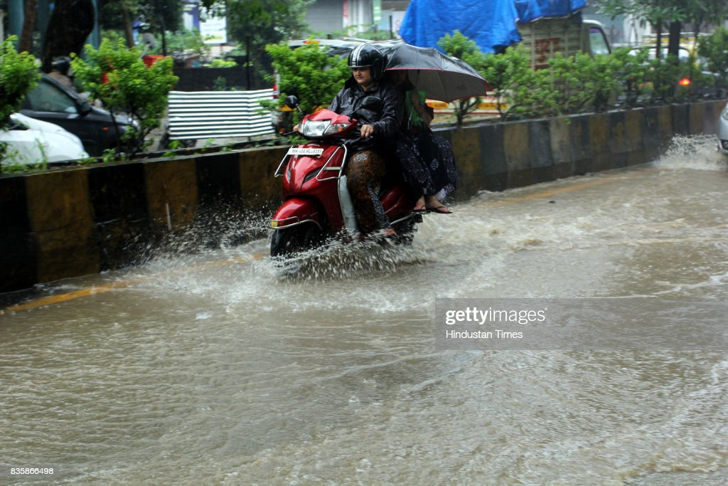 Water-logging following the heavy rain at Gladys Alvares Road, Vasant Vihar in Thane, on August 19, 2017 in Mumbai, India. These weather conditions have been attributed to the presence of a low pressure which is currently lying over the Vidarbha region. Due to this, moisture incursion has increased over Mumbai as well as Thane and the cities have recorded these heavy spells.