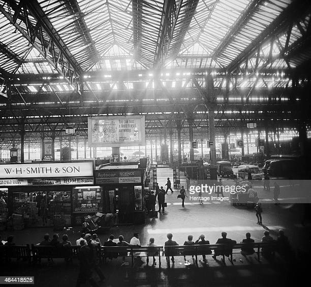 Waterloo Station London 19601972 Elevated view looking across the station concourse towards the platforms with a branch of W H Smith on the concourse