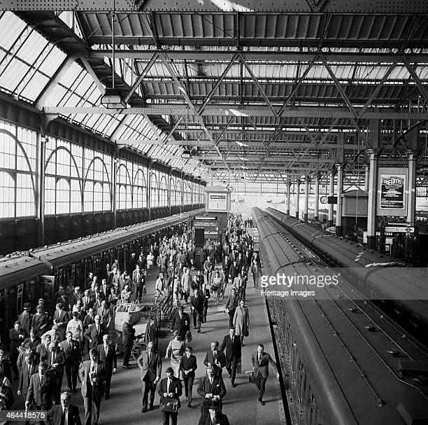 Waterloo Station London 19601972 Elevated view showing crowds of people leaving trains on platforms 1 and 2