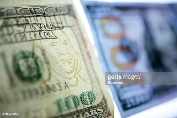 A watermark simulation is seen on a counterfeit $100 bill in the counterfeit specimen vault room at the US Secret Service in Washington DC US on...
