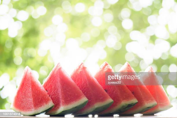 Watermelon fruit in front of green background