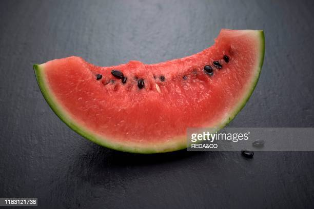 Watermelon fruit on a black background