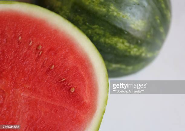 A watermelon on a marble surface