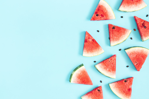 Watermelon pattern. Red watermelon on blue background. Summer concept. Flat lay, top view, copy space 1145766400