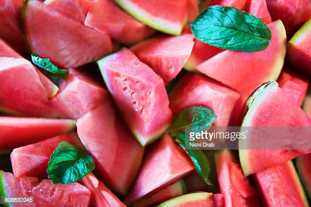 watermelon pieces salad and mint leaves from above - watermelon stock pictures, royalty-free photos & images