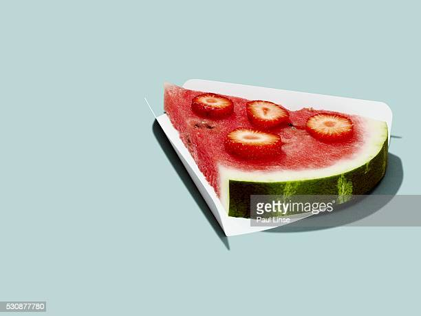 Watermelon slice with strawberries