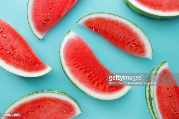 watermelon slices on blue background - watermelon stock pictures, royalty-free photos & images