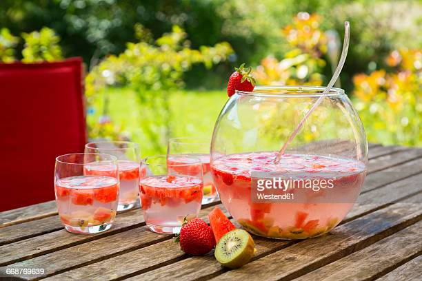Watermelon strawberry kiwi bowle in garden