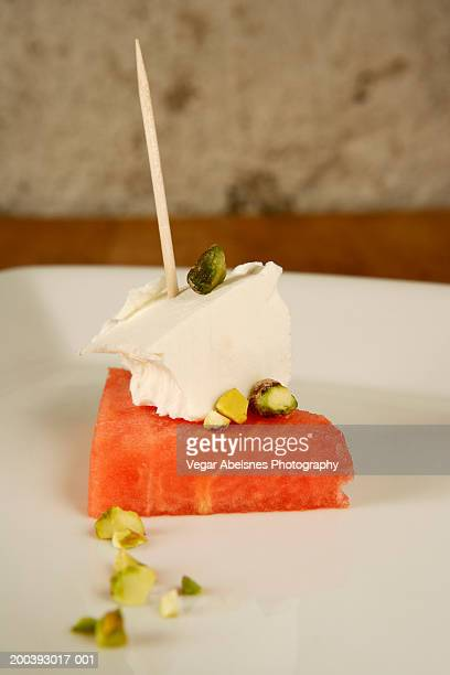 Watermelon with feta cheese and pistacchio nuts |