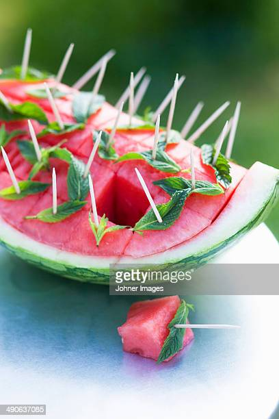 Watermelon with leaves at garden party, close-up