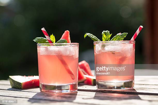 watermelon-hugo, mojito in glasses with drinking straw - cocktail stock pictures, royalty-free photos & images