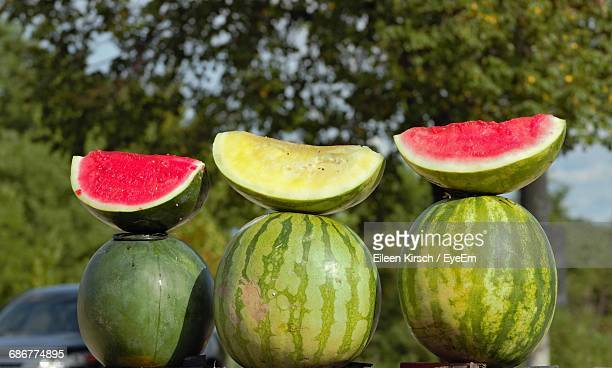 watermelons with slices on table - eileen kirsch stock pictures, royalty-free photos & images