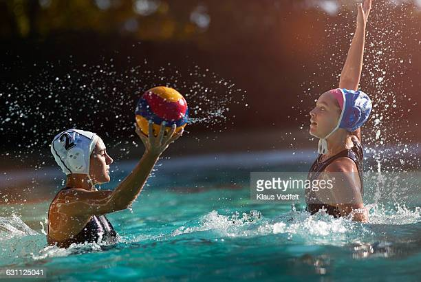 Waterpolo players battling to get the ball