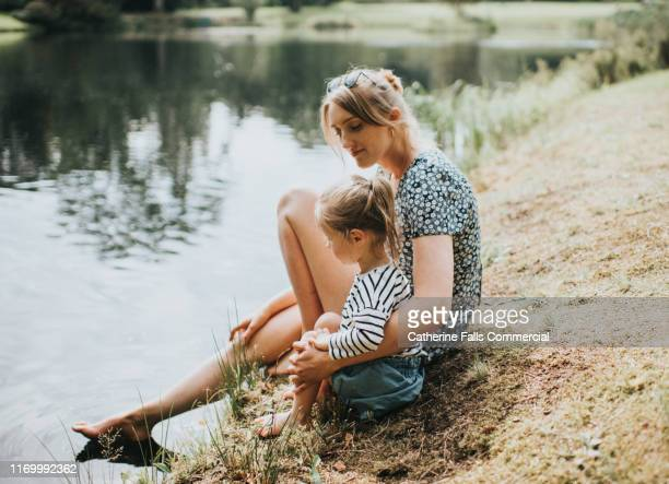 waters edge - mother stock pictures, royalty-free photos & images