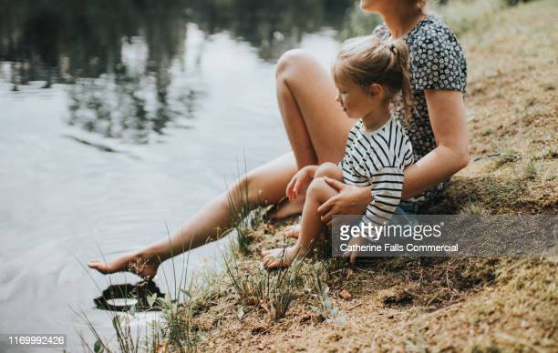 waters edge - niece stock pictures, royalty-free photos & images