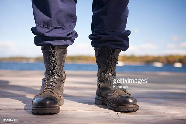 Watershed security guard standing at a dock