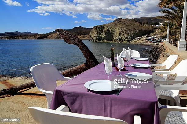 Waterside restaurant table Isleta de Moro village Cabo de Gata natural park Nijar Almeria Spain