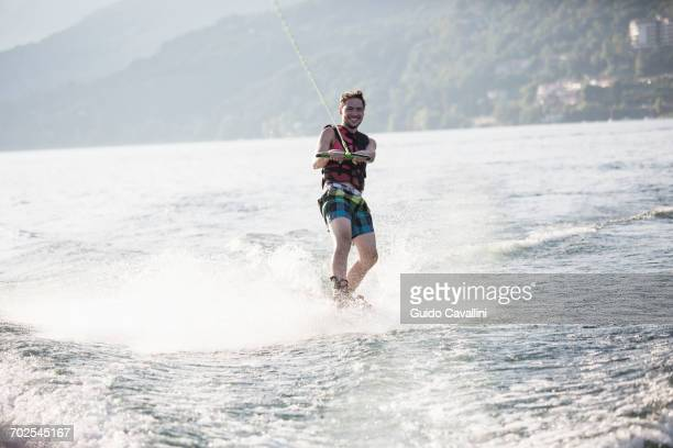 waterskier waterskiing, maggiore lake, verbania, piedmont, italy - waterskiing stock photos and pictures
