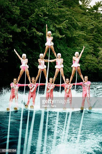 waterskiers forming human pyramid - waterskiing stock photos and pictures