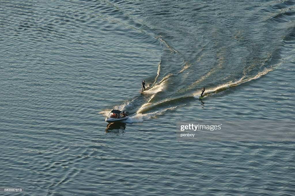 Waterskiing of two skiers : Stock Photo
