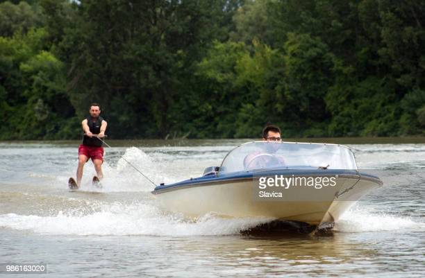 waterskiing on the river - waterskiing stock photos and pictures