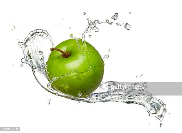 Water-splashed Granny Smith apple