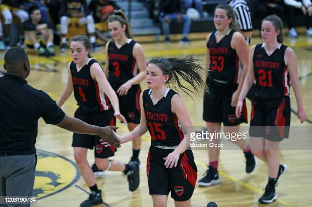 Watertown High School girl's basketball players, from left, Ashley Shaughnessy , Brittany Catsoulis , Ellie Monahan , Taylor Lambo and Brianna...