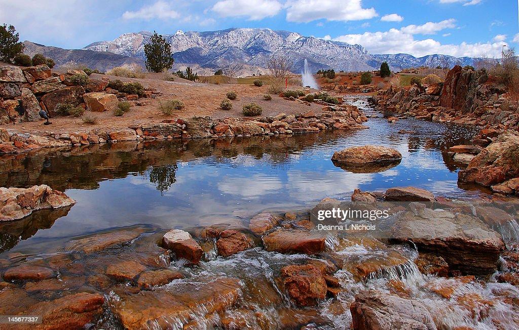 Waterway and Sandia mountains : Stock Photo