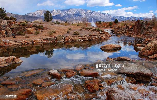 Waterway and Sandia mountains
