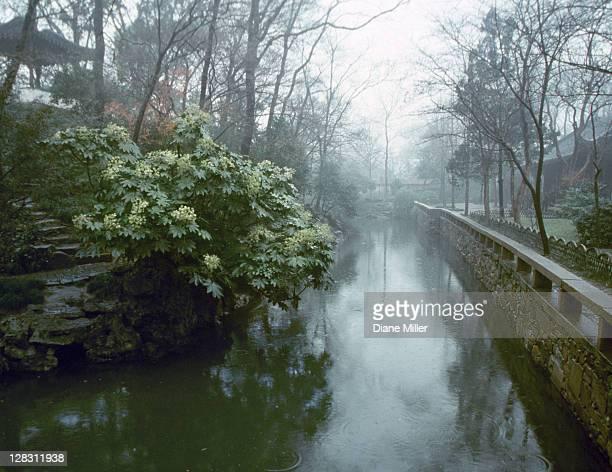 Waterway in misty garden, Suzhou, China