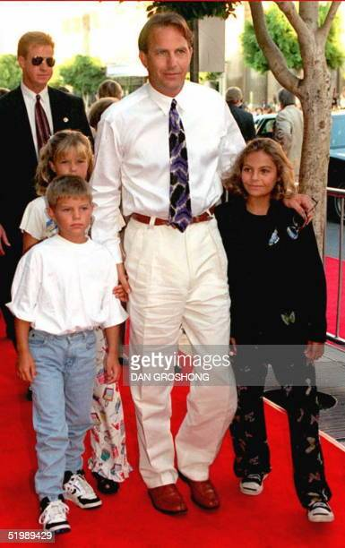Waterworld star Kevin Costner arrives at the movie's premiere with his three children Annie Joe and Lily 26 July at Hollywoods' Mann's Chinese...