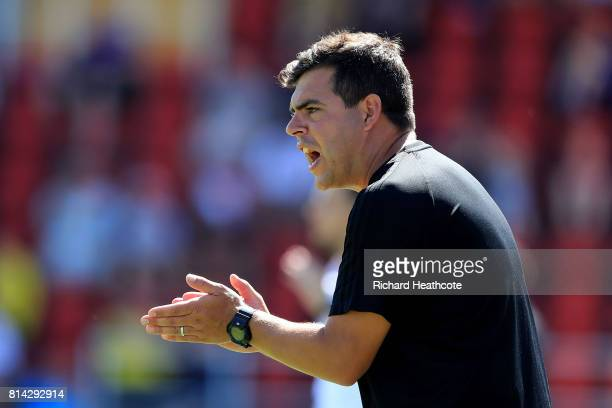Watford academy coach David Horseman gives instructions during the preseason friendly match between Woking and Watford U23 at the Laithwaite...