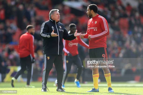 Watford assistant Craig Shakespeare gestures to Troy Deeney of Watford before the Premier League match between Manchester United and Watford FC at...