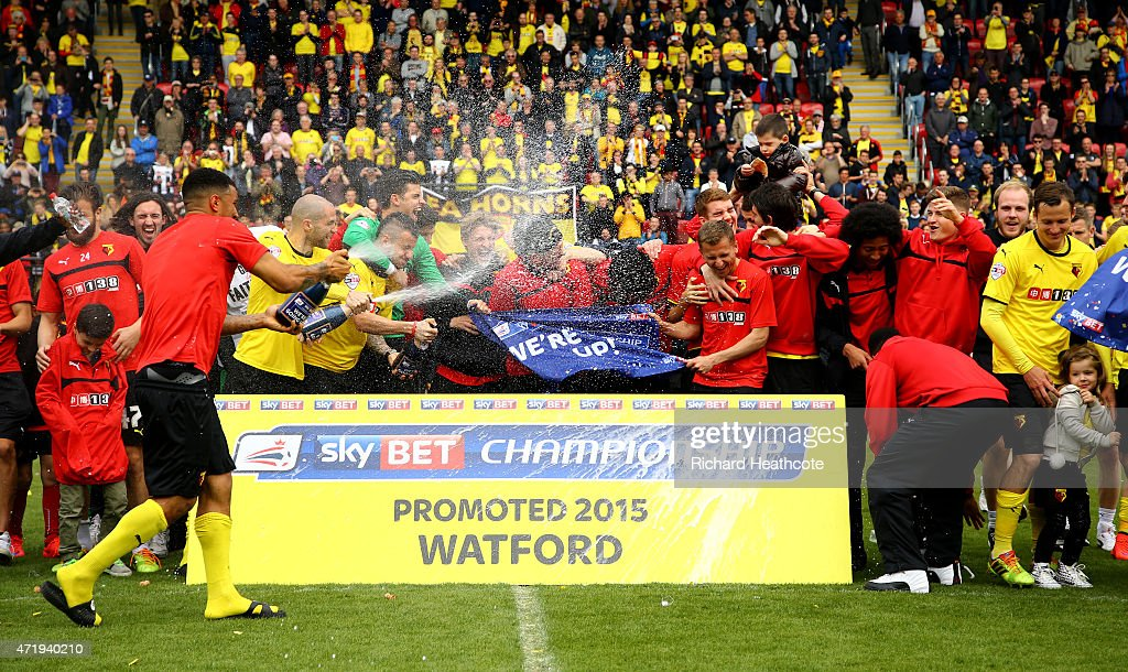 Watford celebrate promotion to the premier league after the Sky Bet Championship match between Watford and Sheffield Wednesday at Vicarage Road on May 2, 2015 in Watford, England.
