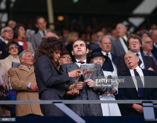 Watford Chairman Elton John and his wife Renate Blauel during the Cup Final hymn Abide with Me sung prior to the FA Cup Final between Everton and...
