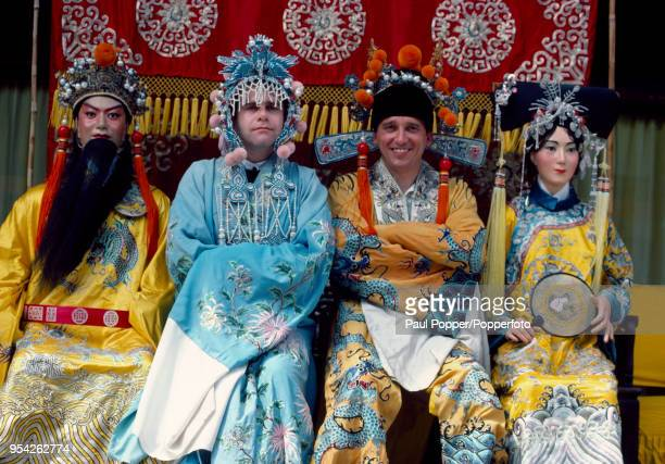 Watford chairman Elton John and manager Graham Taylor in traditional Chinese costumes at the Summer Palace in Beijing during their exhibition tour of...
