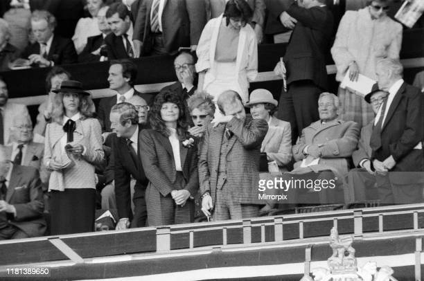 Watford chairman Elton John sheds a tear His new wife Renate soaks up the atmosphere And one lady looks very bored with 90 minutes still to go The...