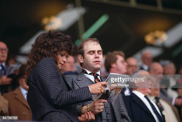 Watford Chairman Elton John singing the Cup Final Hymn Abide with Me with his wife Renata in the Royal Box at Wembley Stadium before the FA Cup Final...